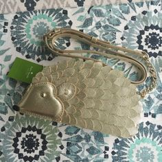 """kate spade hedgehog crossbody, BNWT! kate spade hedgehog creme de la creme crossbody, BNWT!  this item is in brand new condition with tags. Item does not include dustbag (item did come with one from Kate Spade). Measurements are 3.9""""h x 7.8""""l x """"d, adjustable strap is 22"""". Style # - PXRU5945. No trades or PayPal! Price firm!  kate spade Bags Crossbody Bags"""