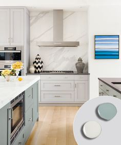 kitchen with gray painted kitchen cabinets and green blue painted kitchen island, marble countertop and backsplash