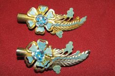 https://www.ebay.com/itm/Vintage-hair-clips-gold-and-turquoise-floral/123057075176?hash=item1ca6c5f3e8:g:L4MAAOSwTmJaw6WY