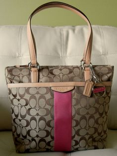 The Coach Signature Tote in Khaki and Pink is a Coach Classic and is a Must Have for your Handbag Collection. Not only does this Handbag look Good but it is made with High Quality Fabrics and will Last a Life Time.  This Tote is Quite Capable of Holding all of Your Personal Items and Does So With...