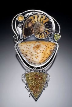 Susannah Ravenswing/Jewels of the Spirit | Aeon Brooch in sterling and fine silver, fossil ammonite, fossilized palmwood, citrine, peridot and druzy pyrite