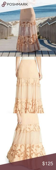 SALE! Free People Lace Inlay maxi NWT SZ 2 & 4, PEACH color. Partially lined sheer maxi skirt with lace inlay in a floral pattern. hidden side zip. Stripes pleats, floral lace and softly rustling tulle combine to create an unforgettable boho chic maxi skirt. Open to fair offers.(pics 2&3 show model wearing a full slip underneath...cover photo is how it looks without adding a longer slip (only the built in mini slip).*MARKED DOWN FROM $ 125, RETAIL $248. Free People Skirts Maxi