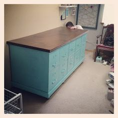 Craft Counter DIY using filing cabinets, spray paint, plywood, casters, and walnut stain