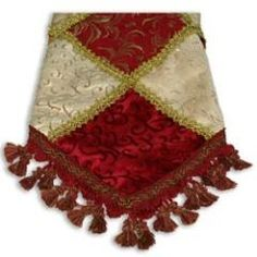 Burgundy and Gold Pattern Tasseled tree skirt at the Santa Claus Christmas Store.