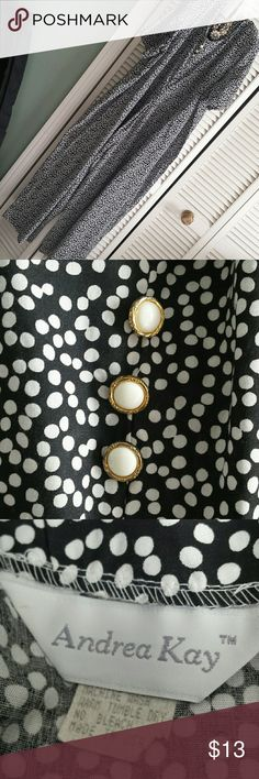 """Vintage Jumpsuit made in USA This is a fun jumpsuit. Black with white polka dots. Zippered back, shoulder pads, wide palazzo type legs measuring up to 20"""" across laying flat! No size tag, my guess is a 3x or 20w to 22w. Measurements are length  is 55"""", pit to pit is 26"""", waist is 25"""", hips at almost 36"""" all laying flat. Shoulder to Inseam is 37"""", Inseam to hem is 24"""" . Small stain on front left around waist area.  Whew!!! Any other questions please ask Andrea Kay Pants Jumpsuits & Rompers"""