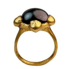 Early Medieval Byzantine Gold Ring. Byzantine Empire, circa 8th - 10th century AD  The gold bezel of the ring is shaped as a quatrefoil - an ancient symbol of good luck, health and fortune.  The original stone didn't survive. The ring was recently set with a cabochon garnet.  The ring comes with a metal analysis report showing 90.73% average gold content (min. reading 89.01%, max. reading 91.60%) with additions of copper 0.329%, silver 8.902%, zinc 0.115%, nickel (-) 0.073%.
