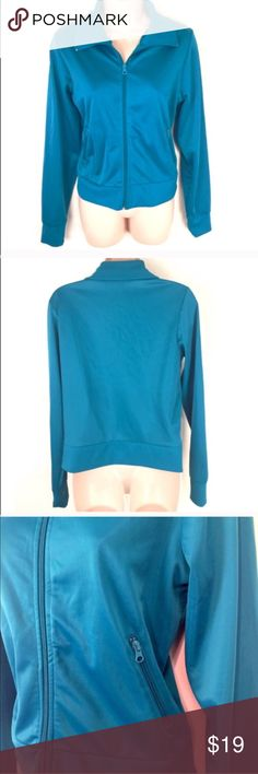 """🔷BOGO 1/2🔷Awesome teal vintage track jacket - Vintage 90s vibes!  - Beautiful teal blue color, full zip.  - Functional pockets.  - Slight stretch. 100% poly.  - Lightweight & comfortable.  - 23"""" long, 25"""" sleeves, 20"""" flat across bust.  - Labeled a large but runs a bit small so I listed as a medium- PLEASE know your measurements.   ✅ I rarely do price drops so please make a reasonable offer OR bundle your likes for a private sale offer!  ✖️I do NOT MODEL ✖️ NO TRADES  Smoke free home. Fast…"""