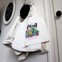 I take my All You Need is Pug totes everywhere, from daily trips to the post office to book runs at the local library. It is so much fun to talk about my shop when people stop me to ask where I got my tote. The bags even make cute office decor when hung!   #etsy #handmade #etsygifts #pug #pugs #dogs #pets #totebag #officespace
