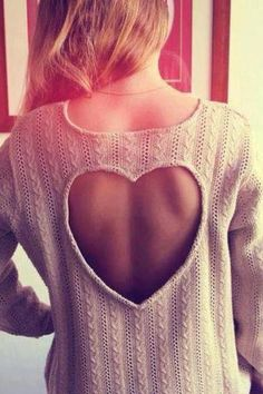Sweater with heart cut out.