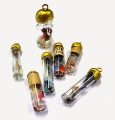Miniature vials as charms.  Resin Crafts