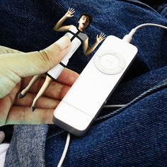 Day 52: Sometimes biggie is so lost in music, she doesn't realize what she is doing. One day I was resting next to her iPod and she pressed me instead to change songs! :/