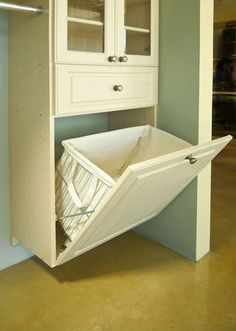 Hidden laundry hamper. Every closet should have one ~ in the mud room even!