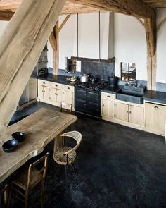 OMG, I am in LOVE with this kitchen! From the soapstone sink and the antique style oven to the wood beam ceiling and the wood slab dining table. This kitchen has rustic country kitchen written all over it!