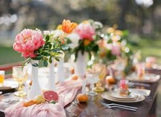 Outdoor Wedding Reception Decor with Vintage, White Vases, Citrus and Orange, Yellow and Pink Wedding Centerpieces on Wooden Farm Table | Tampa Bay Rentals by Tufted Vintage Rentals