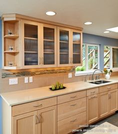 This sleek kitchen design features maple cabinets and Caeserstone counters. This sleek kitchen desig Maple Kitchen Cabinets, Kitchen Countertop Materials, Kitchen Cabinet Hardware, Kitchen Redo, Kitchen Backsplash, Kitchen Countertops, New Kitchen, Limestone Countertops, Quartz Countertops