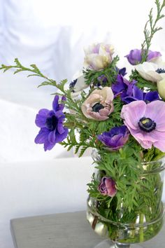 pretty arrangement of pink and purple flowers in glass vase