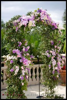 Wedding Planners - Eventrics l Event Design -Event Source Solutions | Isleworth Golf & Country Club l Stunning floral wedding remony arch