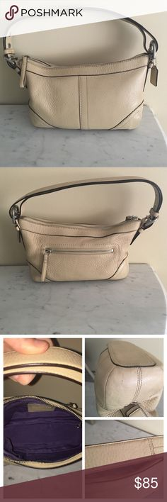 """Authentic Coach Shoulder Bag Pebbled Soft Leather Measure: 12""""(L) x 7""""(H) x 4""""(D).                F12321.Luxurious beige/camel colored pebbled leather, chic silver hardware, and adjustable strap. One exterior zip pocket, two interior slip pockets and a zippered pocket. The strap can be doubled over to be worn on the shoulder (as shown in picture), or adjusted to be worn various lengths.  This bag is in great condition. The Coach tag is a little stained (see picture) but hardly noticeable. A…"""