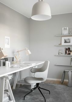 Light grey apartment with pale wood. Stunning work space in light grey.
