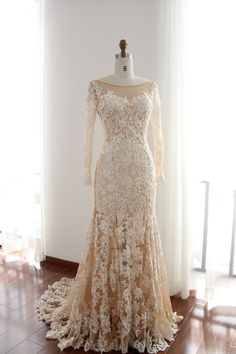 WHAT A STUNNER! Long lace sleeves wedding gown in Ivory and Nude color with sheer neckline, slip skirt underlay. The luxury lace pattern