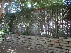 Mirror mosaic fence. Coolest thing ever!