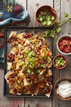 These five-ingredient nachos are a cinch to make for a large crowd. Bake a batch for your next party and serve with an array of topping options, like cilantro, jalapeno peppers, sour cream and salsa.