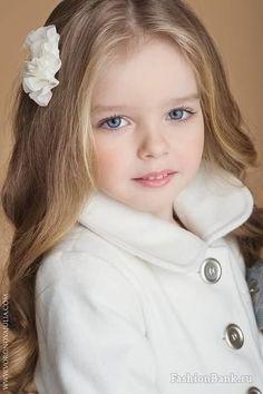 Pretty little girl in beautiful white jacket