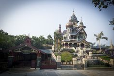 """Mystic Manor is a dark ride attraction in the Mystic Point section of Hong Kong Disneyland. The attraction uses a """"trackless"""" ride system.  Guests get on Henry Mystic's Magneto-Electric Carriages, a vehicle he invented to take guests on a circle tour of the museum. Disneyland Vacation, Hong Kong Disneyland, Haunted Mansion, New Adventures, Girl Humor, Outdoor Spaces, Mystic, Around The Worlds, Mansions"""