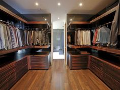This very manly walk-in with lots of wood, has plenty of hanging space for shirts and jackets.