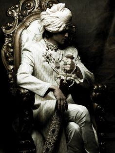 Sherwani, Jodha akbar style. Let me know if anyone know where I can get the sword.