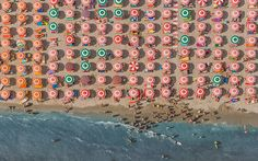 Aerial photographs of the adriatic coastline between Ravenna and Rimini, Italy. Photographed in August As thousands of sun worshipers lazed on the golden sands, sheltering underneath massive beach umbrellas, photographer Bernhard Lang took th.