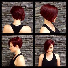 Asymmetrical Frankie Sandford haircut. Red violet hair color