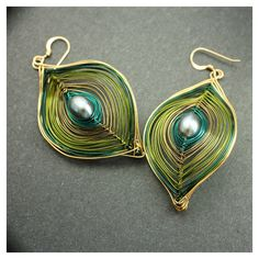 Olive Green and Gold Peacock Earrings Ships Free found on Polyvore