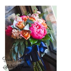 Bridal bouquet with hot pink peonies and milva roses.