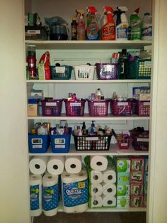 A basic organizing tip anyone can use.  In a hall closet used for backup supplies and toiletries, Organize My Clutter reused and labeled existing containers from the client's home to contain specific categories to help everyone in the home find what they need and to set limits from overpurchasing.