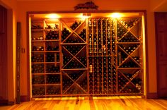Our premium mahogany racks behind a glass door. You can find all the racks you see here on our site, WineRacks.com