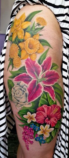 Finished floral piece finally done  Dandelions, Daffodils, Stargazer Lily, White Rose, Hibiscus, Plumeria, Forget Me Nots, and Fireweed all color tattoo  Done by Coral Petrie in Anchorage, Alaska USA