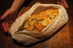Jamie Oliver's Garlic bread baked in parchment. Amazing with fresh thyme and parsley.