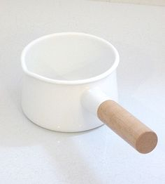 Enamel Milk Pot :: How cute is this? Love enamel and the handle is so cute. Who cares if it takes a million years to clean.
