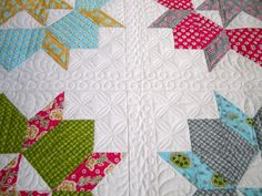 Love the quilting around these Swoon blocks