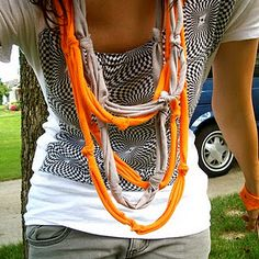 diy clothes and accessories. T-shirt necklace. Cut t-shirt into strips, tie knots in them, layer with different colors, good to go!