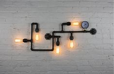 5 Light Pipe Wall Fixture INCLUDES - 5 bulbs of your choice to create a wide variety of looks (shown with antique tube bulbs or Edison bulbs) Measures 43 inches wide Black Finish INTERNATIONAL: Can be used in all countries worldwide. 90V – 240V.