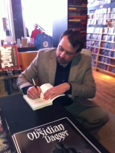 Here I am signing an autograph.