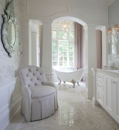 Bathed in Glamour - Love the floor tiles, tub, and mirror.