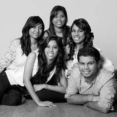 Five siblings pose together in a photograph taken by one of our ex-students and qualified photographers.
