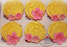 Yellow rose tip frosting with pink royal icing flower