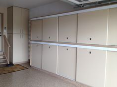 Slotwall, Epoxy Floor, Custom Cabinets, Sliding Doors, Built-in Drawers, Calgary, Garage, Organization, Storage via www.garageplanit.com
