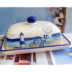 Nautical style butter dished glossy embossed finish Made from ceramic Lovely seaside pattern Finished in blue cream and tan Comes in two parts Approx