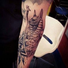 What does anubis tattoo mean? We have anubis tattoo ideas, designs, symbolism and we explain the meaning behind the tattoo. Ankh Tattoo, Anubis Tattoo, Horus Tattoo, Body Art Tattoos, Sleeve Tattoos, Cool Tattoos, Tattoo Art, Tattoo Designs And Meanings, Best Tattoo Designs