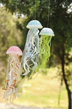 The perfect summer decor? Homemade sea creatures that flutter in the breeze.        Collect materials for the tentacles: we used curling ribbon, a few strips of bubble wrap with 1/2-inch-wide bubbles, a bath pouf (cut open and unwound), and heavy-duty paper towels cut into spirals. Our tentacles are 12 to 18 inches long.    Gather the tentacles at one end and thread them up through the hole of a plastic dome drink lid (from a coffee shop or convenience store). Tape the ends around the…